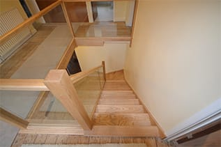 bespoke wood and glass staircase design