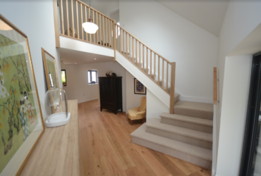 carpeted stairs & oak balustrade after 5