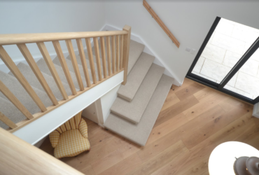 carpeted stairs & oak balustrade after 2